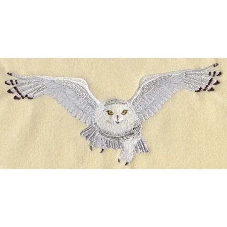 sněžná sova v letu